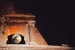 archeology architecture biggest canon cielo cold colosseo colosseum darkrome dreaming fabulous fullmoon goldenmoon igersroma italy legend life lunapiena moonhunter night november poetry roma ruins skyporn stars stories superluna supermoon window