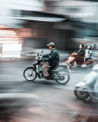 asia backpackers city crowd discover hanoi moto motorbike scooter speed traffic travel vietnam